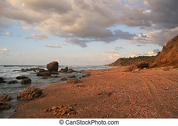 Red sand on the shores of Mediterranean Sea.