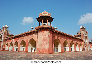 Red sandstone Akbar's tomb in Agra, India