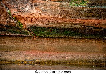 Red sandstone cliff near the river. - Closeup of sandstone...