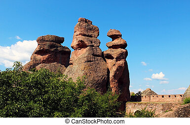 Red sandstone rock pillars against clear blue sky in Belogradchik