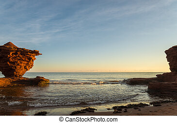Red sandstone rocks at high tide (Green Gables Shore, Prince Edward Island , Canada)