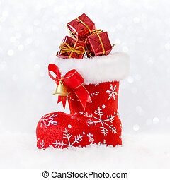 red santa's stocking with gifts in snow, christmas card