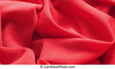 Red satin fabric background, slow motion