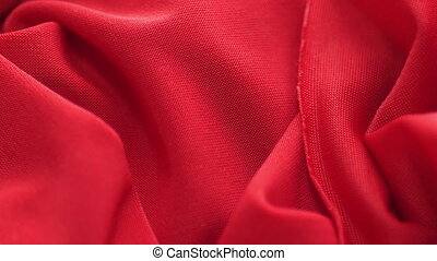 Red satin fabric background slow motion