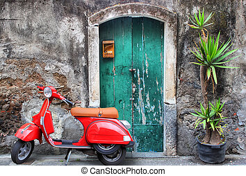 Red scooter - Photo of red scooter near green door and palm