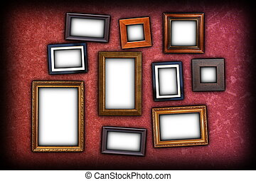 red scratched wall with frames