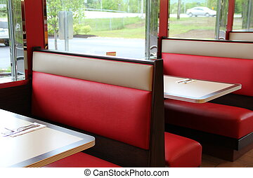 Red seats and tables at diner
