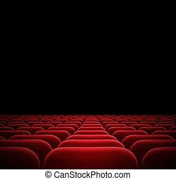 red seats in dark cinema theater