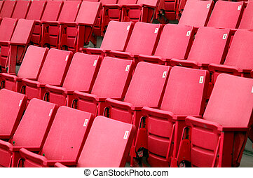 Red Seats - Rows of empty red seats
