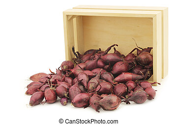 red seed onions in a wooden box