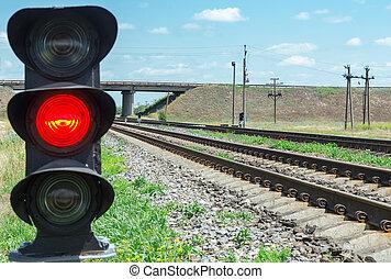 red semaphore near railroad