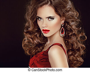Red sexy lips. Stare. Beauty Brunette Girl Model with luxurious wavy long hair isolated on dark background