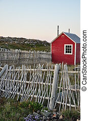 red shed and twig fence