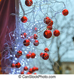 Red shiny balls on Christmas street in Paris, France