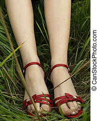 Red shoes in grass
