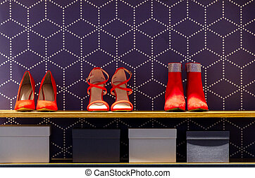 red shoes on shelf in store