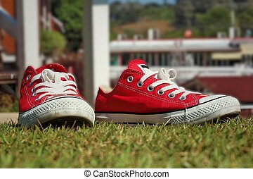Red shoes on the grass - Sneakers.