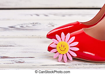 Red shoes on wood.