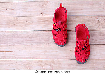 Red shoes sandle isolated on a wooden background