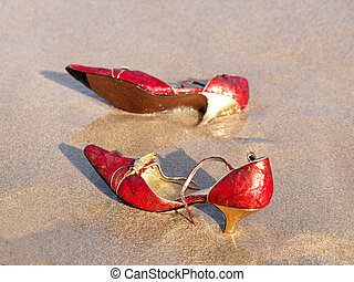 red shoes              - red and golden shoes on the beach