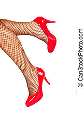 Red shoes with fishnet stockings