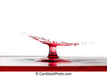 Red side impact - Beautiful high speed image of a water drop...