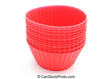 Red silicone cups on white background