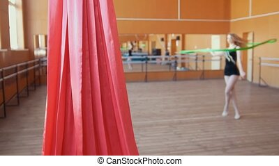 Red silk in front of young woman training a gymnastics...