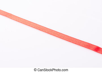 Red silk twisted ribbon in the form of line