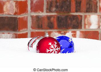 Christmas ball ornaments on snow
