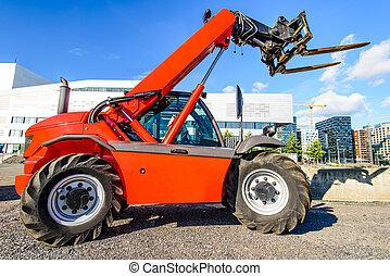 red skid steer - skid steer loader at construction area near...