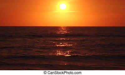 Red sky horizon hung over the water space at sunset - Red...