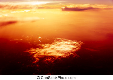 Red sky, sunset and  clouds. Flying over Clouds