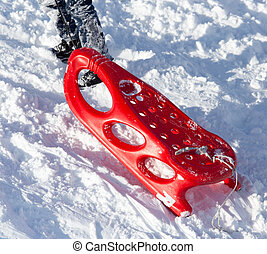 red sled in the snow