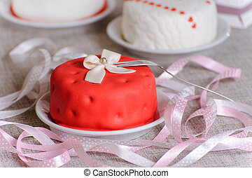 red small cake on a plate