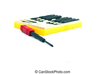 Red small screwdriver and yellow box on white background