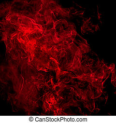 Red smoke over black studio background