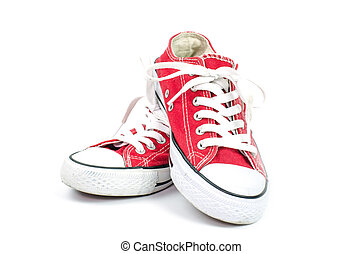 Red sneakers on a white background.