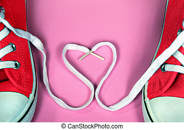 red sneakers with shoestring heart - pair of bright red...