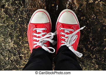 Red sneakers with white laces