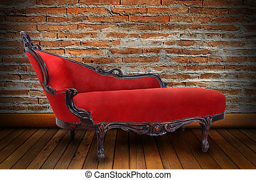 Red sofa in sitting-room with brick wall