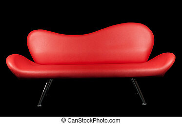 Red sofa on black background