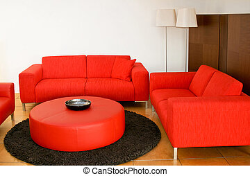 Red sofas in the living room with lamp