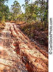 Red soil road damaged.