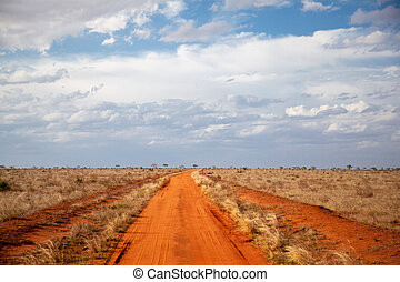 Red soil way, blue sky with clouds, scenery of Kenya