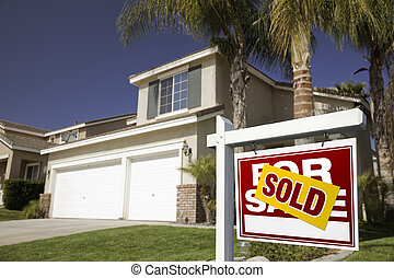 Red Sold For Sale Real Estate Sign and House