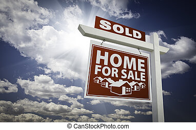 Red Sold Home For Sale Real Estate Sign Over Clouds and Sky...