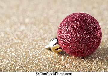 Red Sparkly Bauble on Gold Glitter