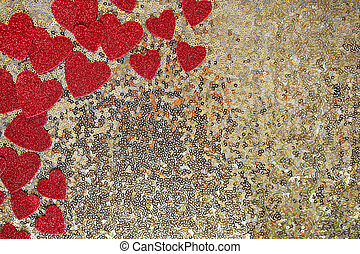 Red Sparkly Heart Confetti Framing Gold Sequin Background