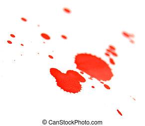 Red splashes on the white.
